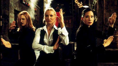 three women standing fighting