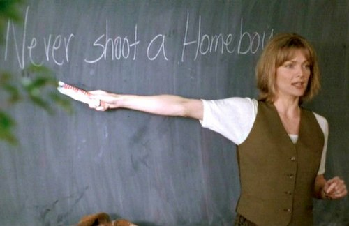 woman standing in front of chalk board pointing