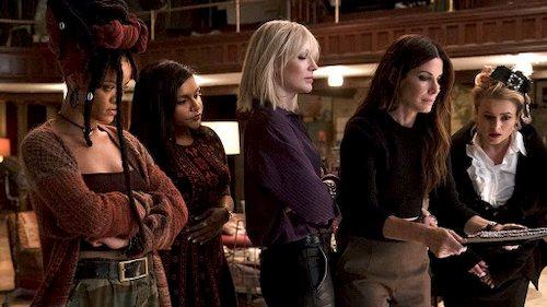 five women standing talking