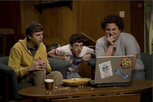 boys looking at laptop screen