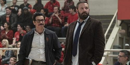 two men standing basketball court