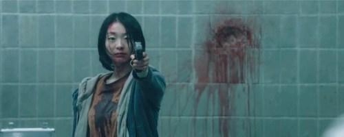 girl standing holding gun