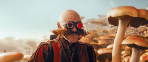 bald man with big goggles and moustache in mushroom land