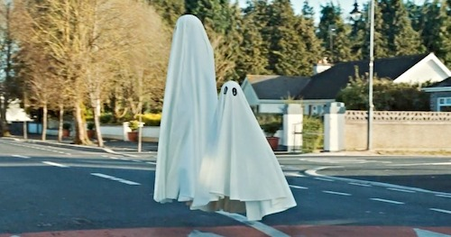 two ghosts crossing the street