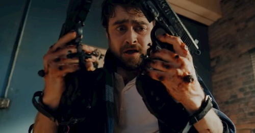 man holding two guns