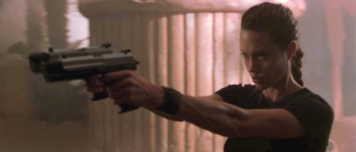 woman holding pointing two guns