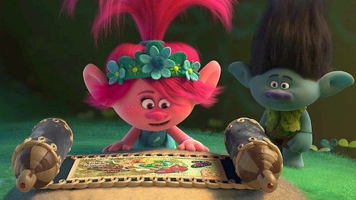 two colorful trolls staring at map