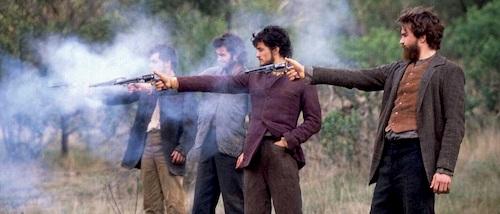 group of men shooting guns