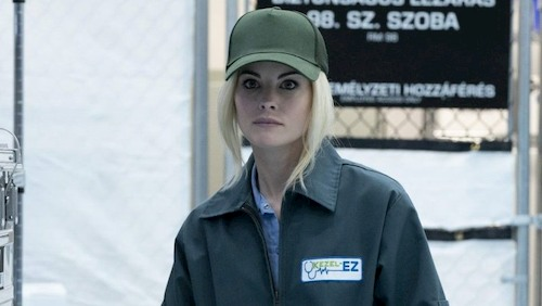 blonde woman with baseball cap