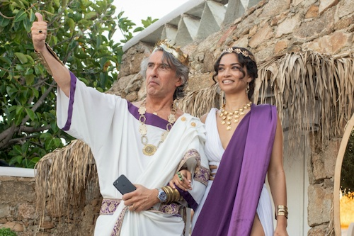 man and woman in white and purple roman garb smiling