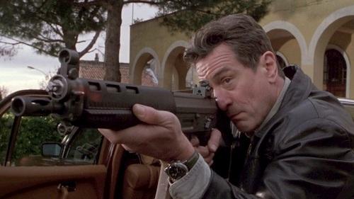 man holding gun ready to shoot