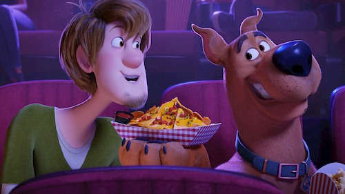 animated man and dog eating nachos in movie theater