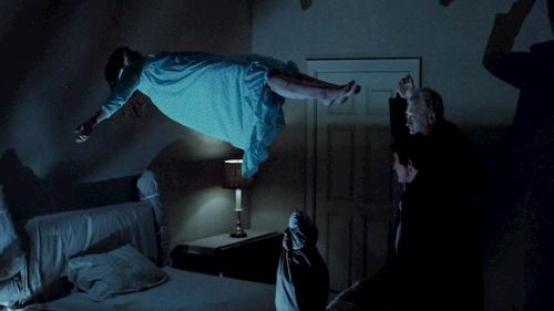 girl floating in bedroom