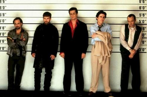 men posing for police photo