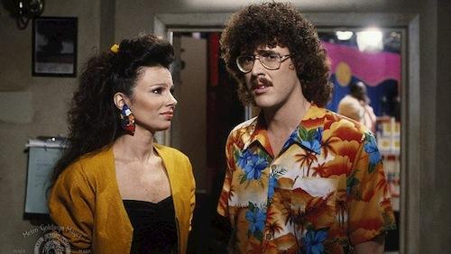man with hawaiian shirt standing next to woman