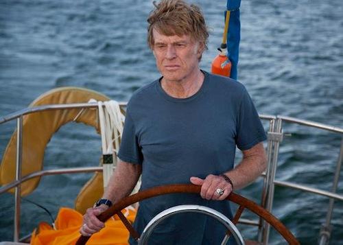 man steering boat in the ocean