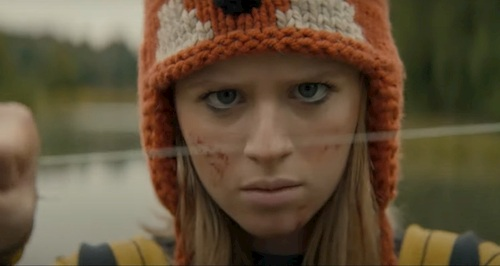 girl in fox hat holding string