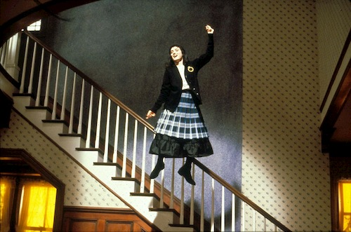 woman dancing in the air on top of stairs