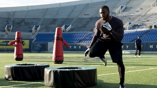 man doing football training on field