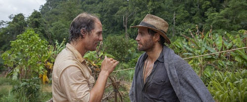 two men talking in the jungle