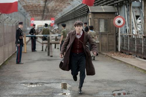 man running down street