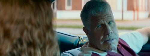 man talking to girl in car