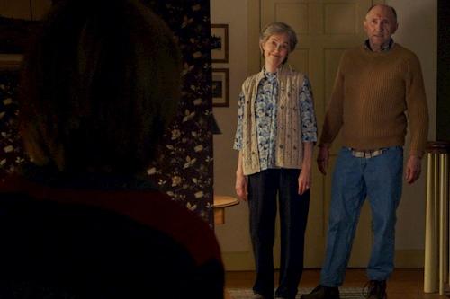 grandparents standing in hallway