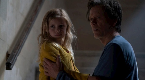 dad and daughter on dark staircase