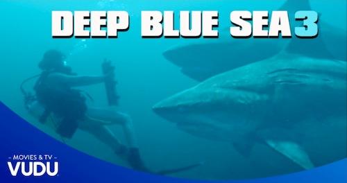 sharks under water deep blue sea