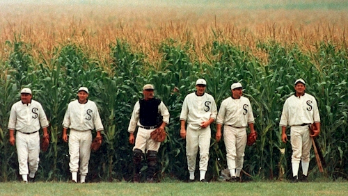 baseball players coming out of corn field