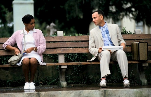 man and woman talking on bench