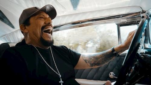 man driving smiling