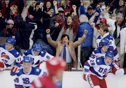 hockey players and crowd cheering on ice rink