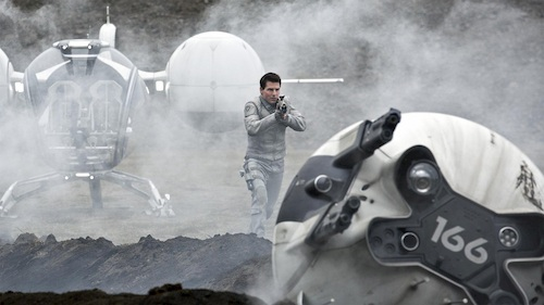 man pointing gun at robot