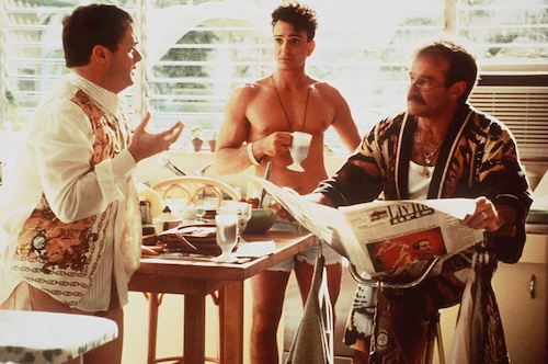 three men talking at table