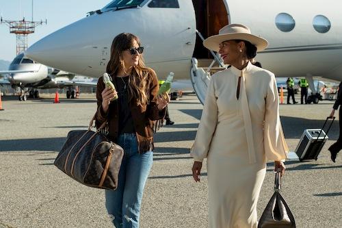 two women walking out of airplane talking