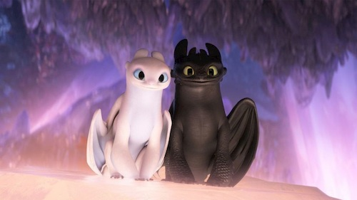 animated black and white dragon sitting together