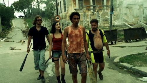 group of people walking through street
