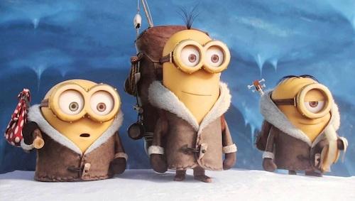 three yellow minions in winter coats