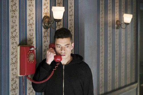 man talking on red phone