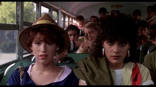 teenage girls sitting on school bus