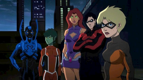group of superheros standing together in night