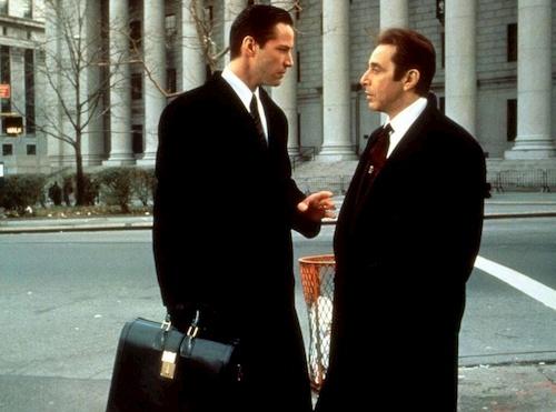two men in black talking