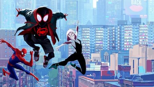 3 spider people swinging through city