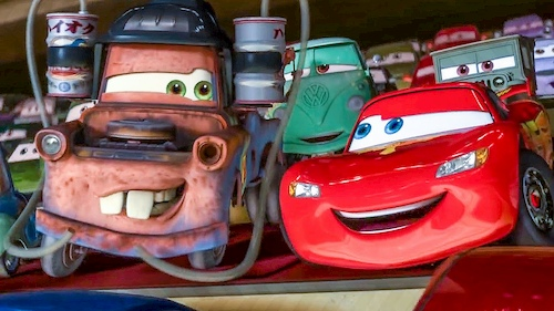 animated cars smiling at each other