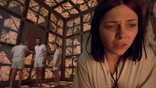 people inside talking inside giant cube